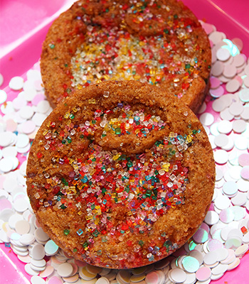 Picture of two delicious cookies covered with colorful sugar sprinkles.