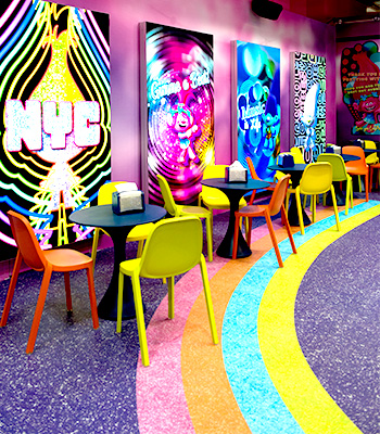 Colorful tables and chairs at the Cupcakes & Rainbows Retail Shop & Café