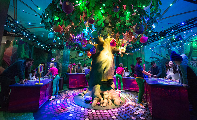 Guest gather around the beautiful Trolls Tree for the After Party scrapbooking activities
