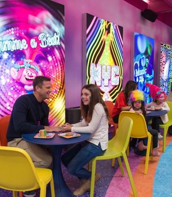 Families sitting down eating treats at the Cupcakes & Rainbows Retail Shop & Café