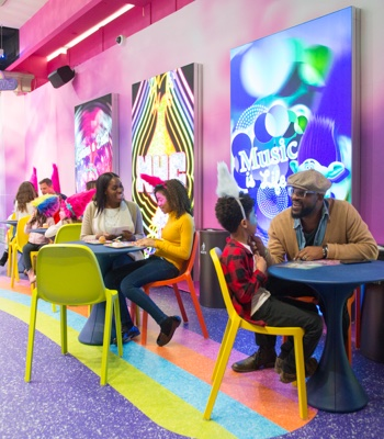 Various families enjoying snacks and time together at the Cupcakes & Rainbows Retail Shop & Café