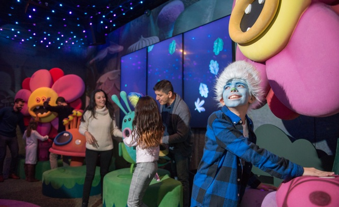 Guests playing music with Trolls critters at Branch's Musical Mash Up